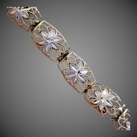 "6.7 Grams, 10K Two Toned YG Floral Link Bracelet 7 1/2"" Closed"