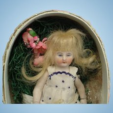 Antique All-Bisque Girl w/ Bunny in EGG #5034