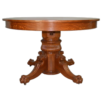 """Tiger Oak 48"""" Round Lion Head Dining Table"""