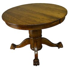 Round Oak Claw Foot Dining Table with 2 Leaves