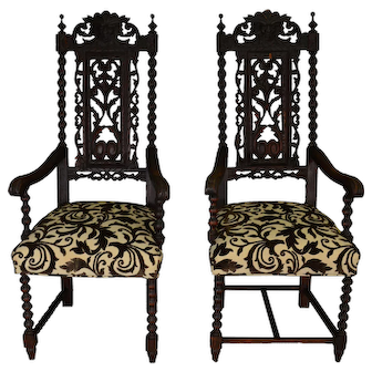 Two High Carved Oak Lion Headed Master Chairs
