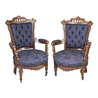 Pair of Aesthetic Movement Carved Walnut Armchairs