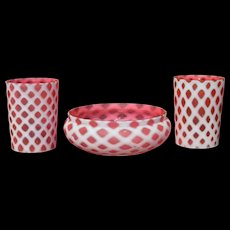 Two Pink and Opalescent Tumblers with a Bowl
