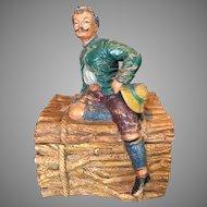 Vintage German Terracotta Tobacco Figural Humidor Man Sitting on Logs 19th Century