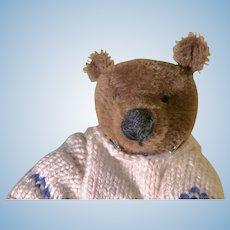 Dark brown small mohair artist teddy bear with sweater