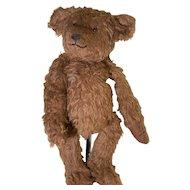 Large brown shaggy mohair artist bear smiling