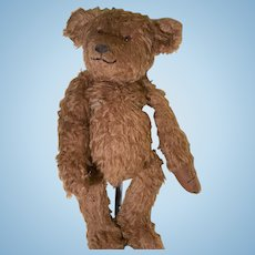 Large brown shaggy mohair artist bear smiling