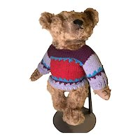 Sparse gold mohair artist bear with colorful sweater