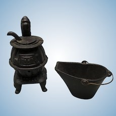 Black wrought iron potbelly stove with ash bucket