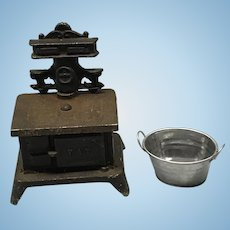 Black wrought iron stove with silver ash bucket