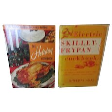 "1950s ""The Holiday Cookbook"" and ""Electric Skillet Fry Pan""."