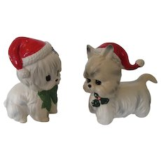 Two Decorative White Dogs Dressed for Christmas