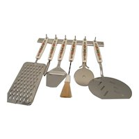 Six Spice of Life Kitchen Tools with a Rack for Hanging 1970s