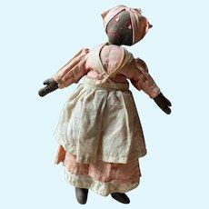 Wonderful 1920s or 1930s Black Oil Cloth Doll