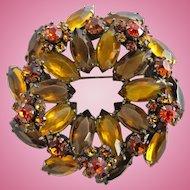 Vintage Alice Caviness Amber Rhinestone Pinwheel Circle Pin