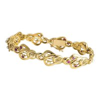 French 18 kt yellow gold Ruby and Pearl Bracelet.