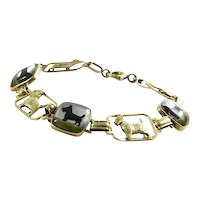 14K Yellow Gold Scotty Reverse Painted Crystal Bracelet  Description: