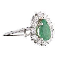 Platinum Diamond and Emerald Ring.