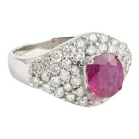 Ruby and Diamond ring set in 18kt White Gold.