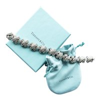 Tiffany & Co. Silver and 18kt. Yellow Gold X Bracelet.