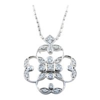Delicate 18KT Gold and Diamond Four Leaf Clover Pendant