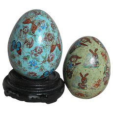 Vintage  Porcelain or Ceramic  Decorated Eggs  One with Butterfly's, flowers and  one with Rabbits