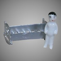 Tiny Frozen Charlotte doll with Tiny Metal Crib  Bed