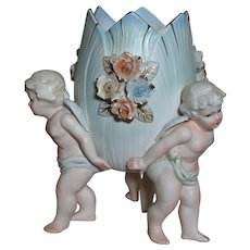Porcelain Cherub Vase  Three Cherubs hold the vase up  Lefton