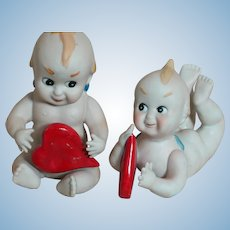 "Two Bisque  Kewpie's Holding Red Hearts 3-3/4"" to 5"" tall"