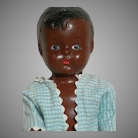 """Vintage Black Composition Baby Doll Jointed  Unmarked  Painted Eyes.  13"""""""