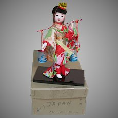 Small Oriental Geisha Doll in Original Box Glass Eyes  Wood Base 6""