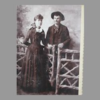 Interesting photo Of a Young Couple Standing at a Fence  Late 1800's