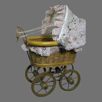 "Vintage Baby Doll Buggy  Wicker Wood Wheels 19"" High  14 "" Long  8 wide"