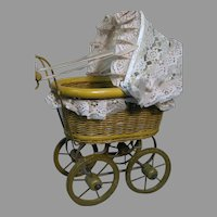"Vintage Baby Doll Buggy  Wicker Wood Wheels 19"" High  14 "" Long  8 wide"