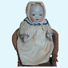 """All Bisque Jointed baby Swivel Neck Doll  5""""  Glass Eyes  sitting in Wicker Chair"""