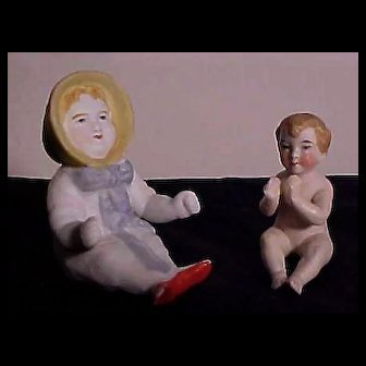 Two German All Bisque Seated Children