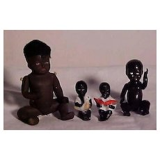 Group Of Four Black Character Dolls