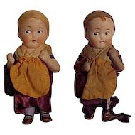 Pair Of German All Bisque Character Children