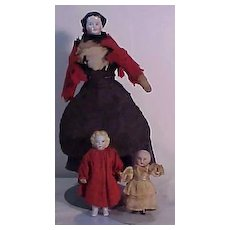 A Trio Of Early Dolls Consisting Of Two All Bisque Dolls And A China