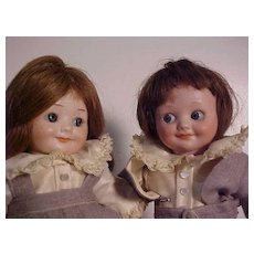 Pair Of Googly Children With Matching Outfits