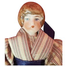 Pretty Antique German Bisque Doll house doll with her hair in a bun