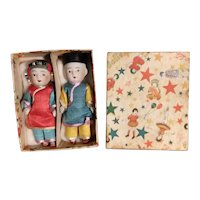 A Pair Of Bisque Asian Children Who Are Mint In Their Original Box
