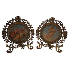 Vintage pr. of cherub lithographs in ornate brass frames