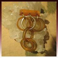 ON SALE Gorgeous Dangling Bakelite Brooch many Rings