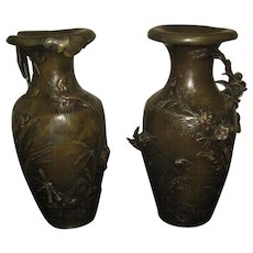 Pair of Bronze Vases with an Elaborate Floral Deocation in High Relief