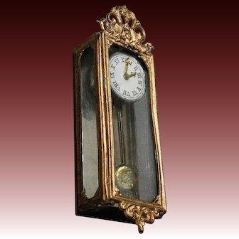 German Painted Soft Metal Hanging Clock with Swinging Pendulum