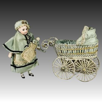 All Original Antique All-bisque French Mignonette with Baby and Pram