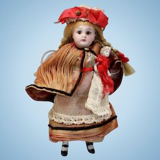 Solid-domed All-bisque French Mignonette in Original Nanny Costume