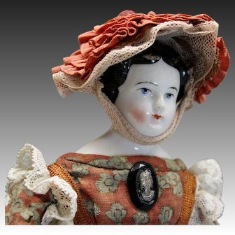 Early German China Doll with Articulated Leather Body
