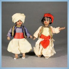 Pair of French All-Bisque Exotic Brown Dolls with Bare Feet